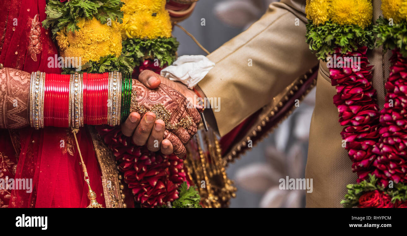 Beautiful photo of a Newly Married Indian Couple holding hands and promising each other for living together merrily for all their life. - Stock Image