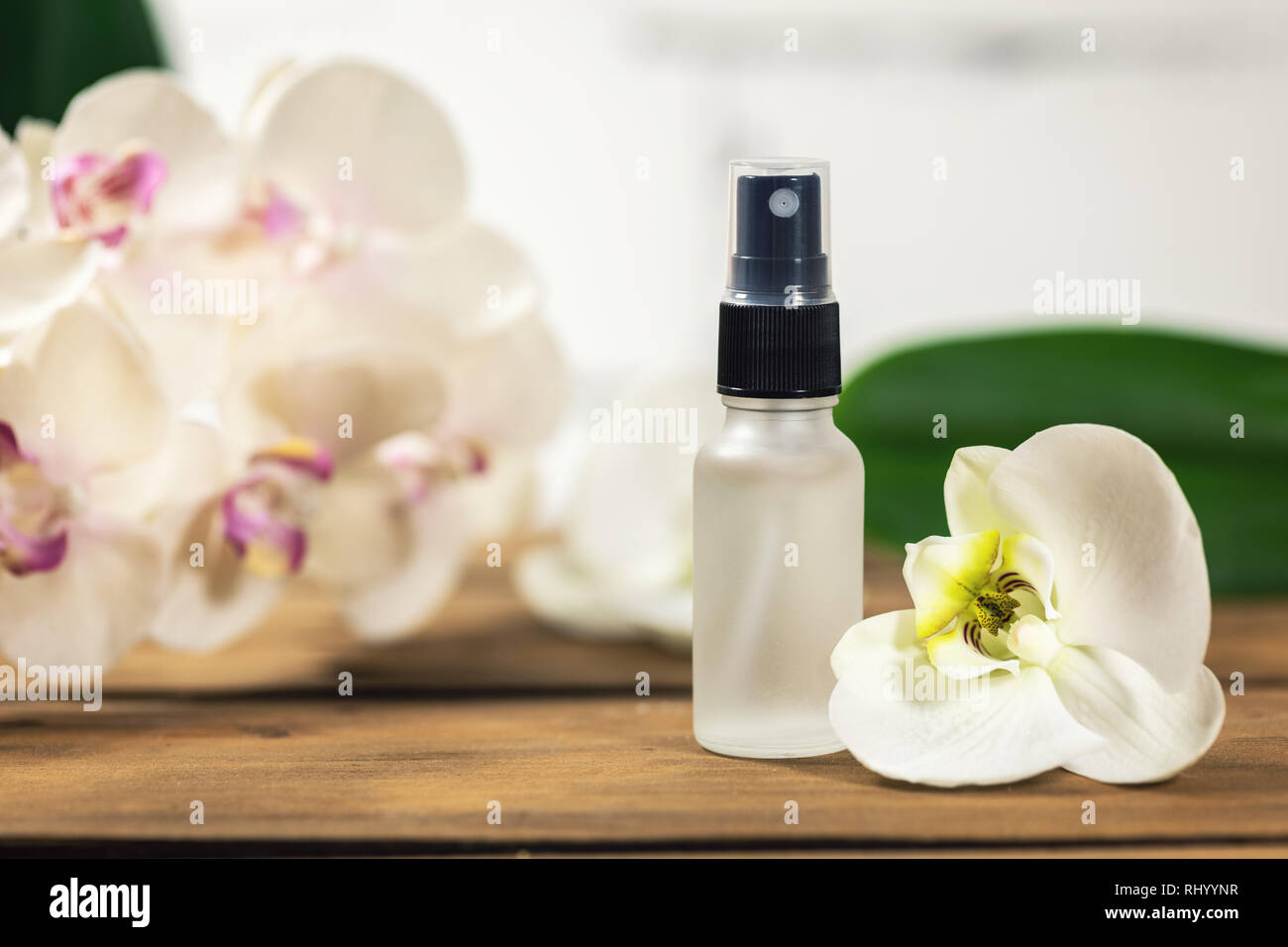 floral scent perfume sprayer with orchid flower - Stock Image