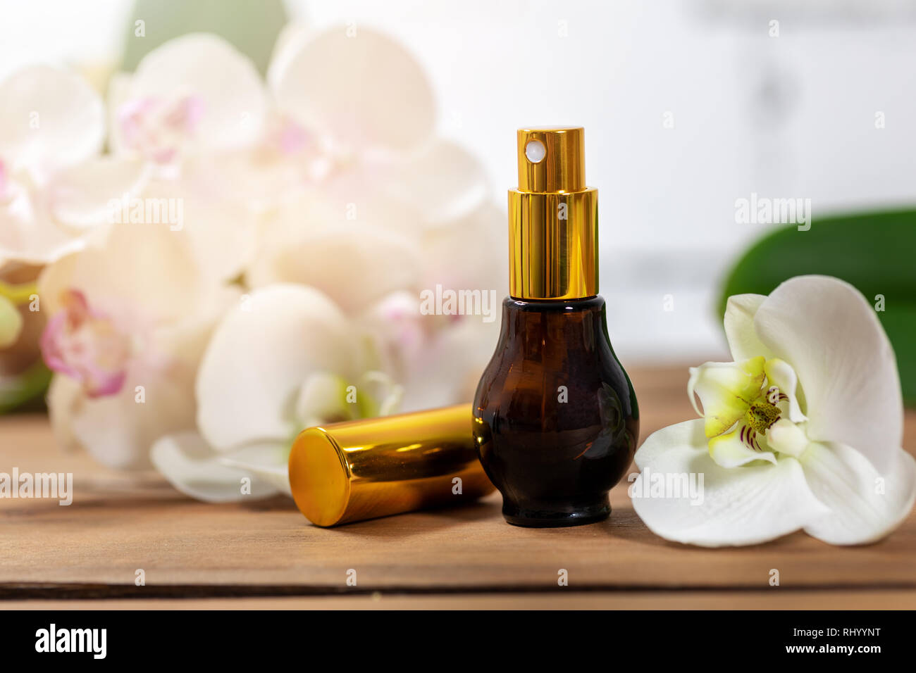 floral scent perfume atomizer with orchid flower - Stock Image