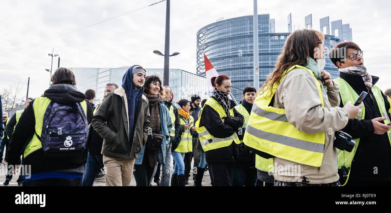 STRASBOURG, FRANCE - FEB 02, 2018: Crowd of people demonstrating in front of European Parliament during protest of Gilets Jaunes Yellow Vest manifestation on the 12 Saturday of anti-government demonstrations Stock Photo