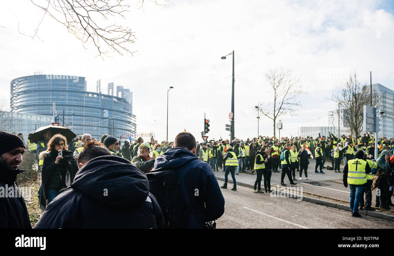 STRASBOURG, FRANCE - FEB 02, 2018: People demonstrating walking during protest of Gilets Jaunes Yellow Vest manifestation on the 12 Saturday of anti-government demonstrations - Stock Image