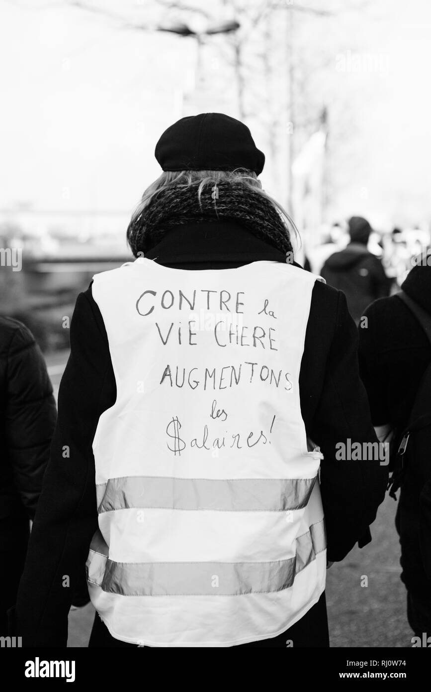 STRASBOURG, FRANCE - FEB 02, 2018: People demonstrating during protest of Gilets Jaunes Yellow Vest against the expensive life - increase in wages black and white image - Stock Image