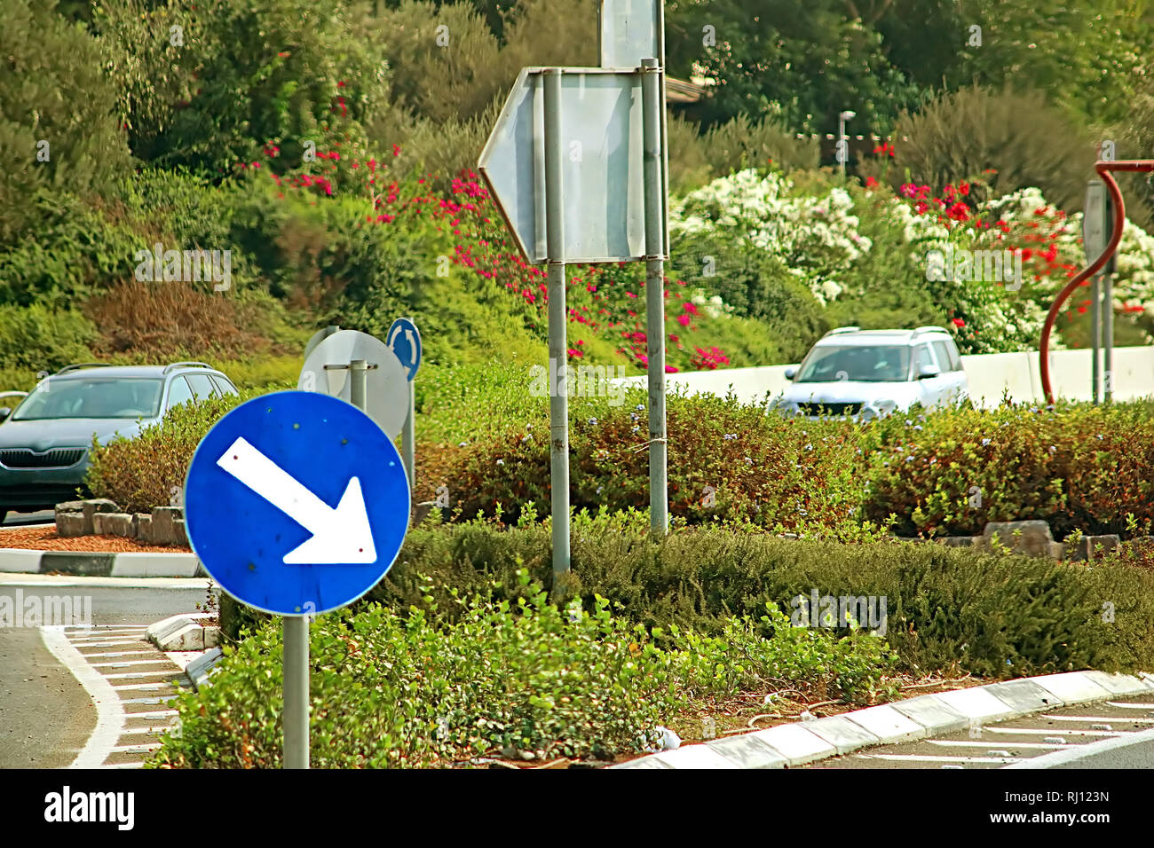 Road sign arrow on the road in Israel - Stock Image