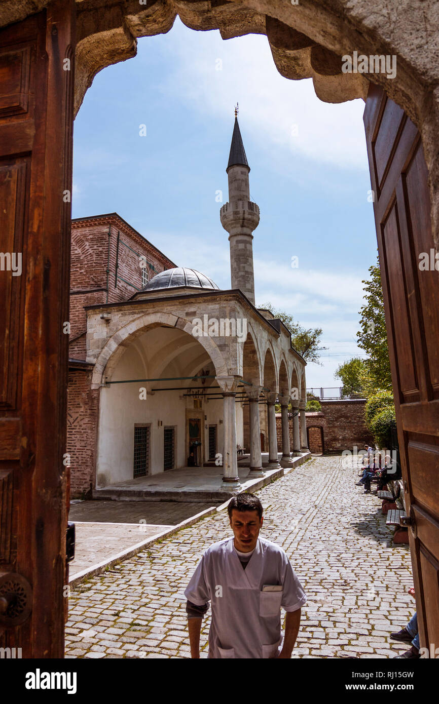 Istanbul, Turkey : A man walks under the entrance arch of the Little Hagia Sophia mosque formerly the Byzantine Church of the Saints Sergius and Bacch - Stock Image