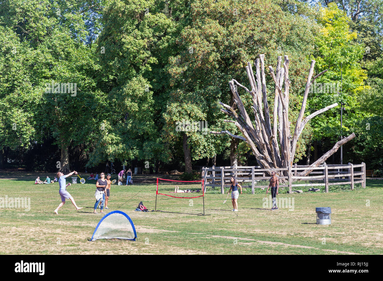 Parc municipal in Luxembourg city with recreating people playing badminton - Stock Image