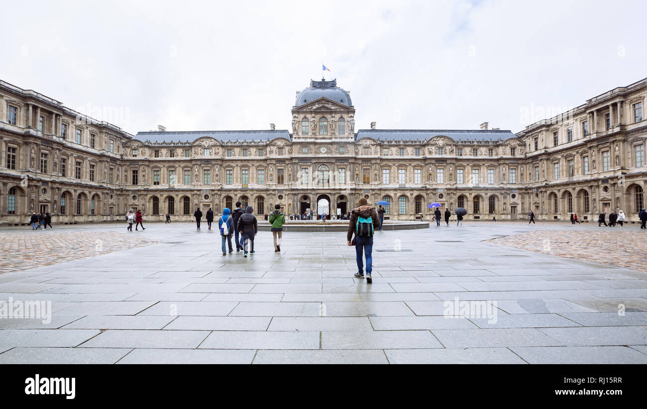 Paris (France) - View of famous Louvre Museum in a winter and rainy day. Louvre Museum is one of the largest and most visited museums worldwide Stock Photo