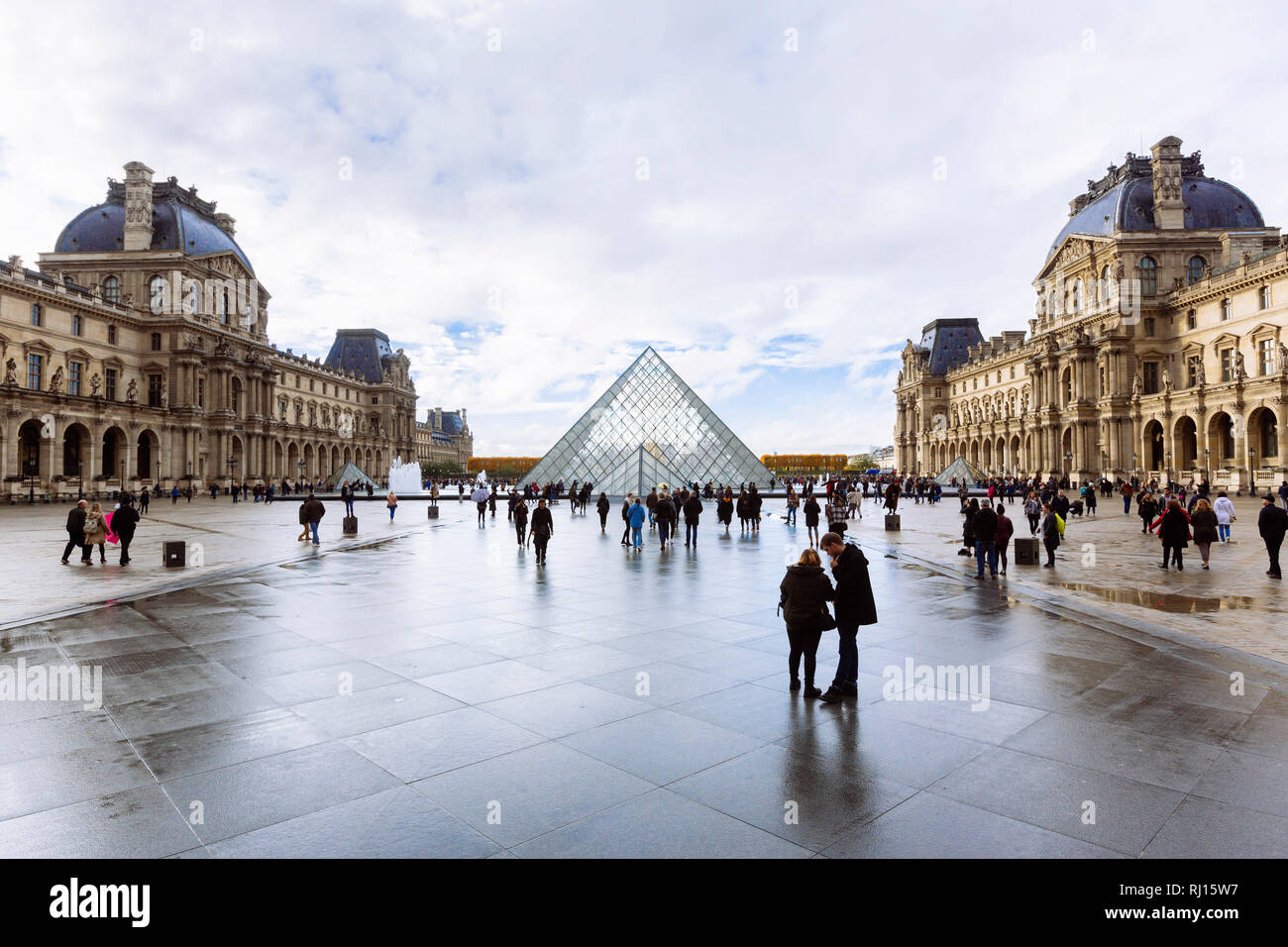PARIS, FRANCE - NOVEMBER 10, 2018 - View of famous Louvre Museum and Pyramid in a winter and rainy day. Louvre Museum is one of the largest and most v Stock Photo