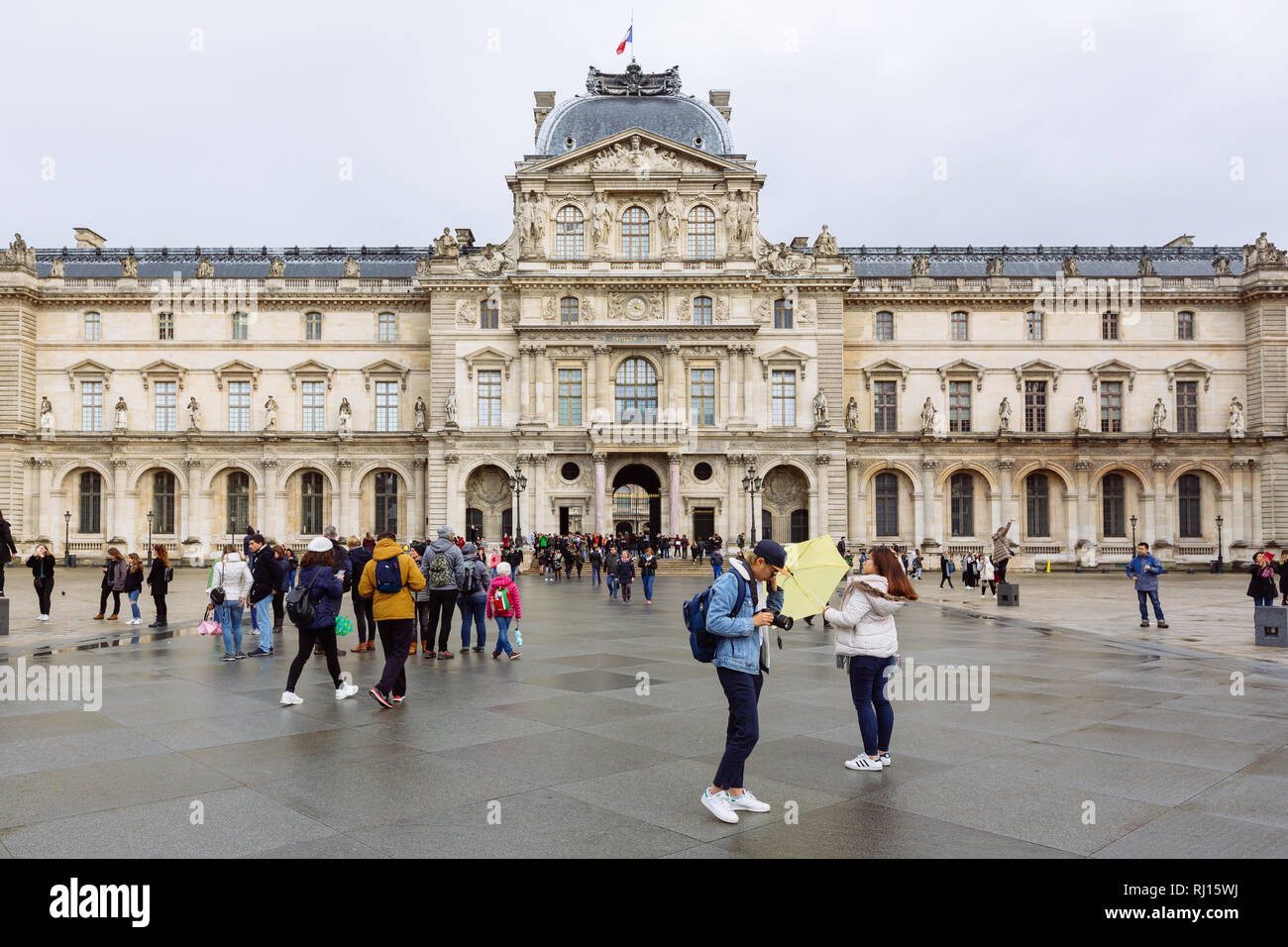 PARIS, FRANCE - NOVEMBER 10, 2018 - View of famous Louvre Museum in a winter and rainy day. Louvre Museum is one of the largest museum worldwide Stock Photo