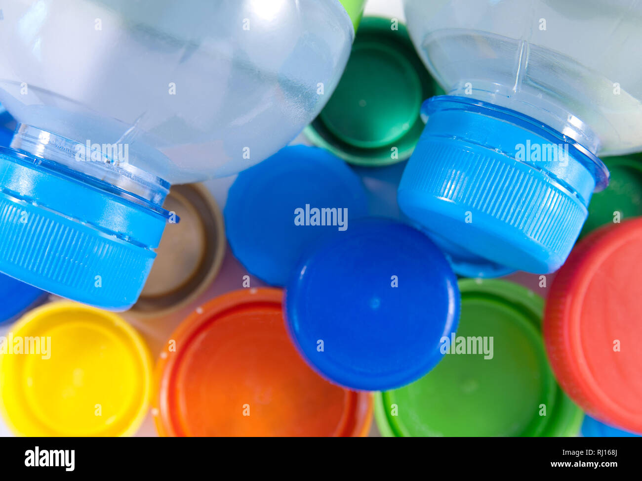 Two bottles of water and colorful covers. Closeup image - Stock Image
