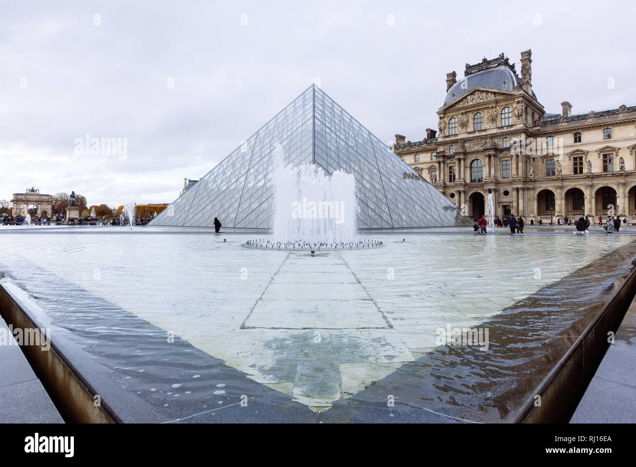 Paris (France) - View of famous Louvre Museum and Pyramid in a winter and rainy day Stock Photo