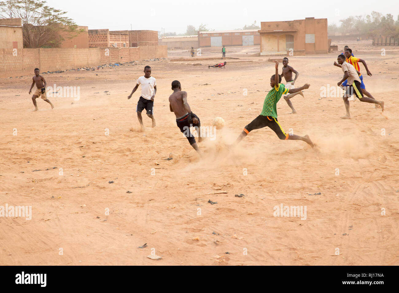 Yako, Burkina Faso; boys playing football after school - Stock Image
