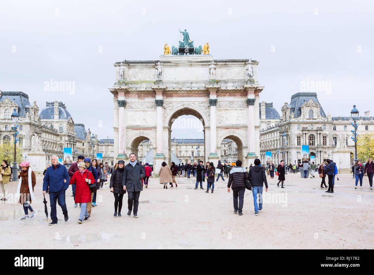 PARIS, FRANCE - NOVEMBER 10, 2018 - View of famous Arc de Triomphe du Carrousel against the background of the Louvre Museum in Paris Stock Photo