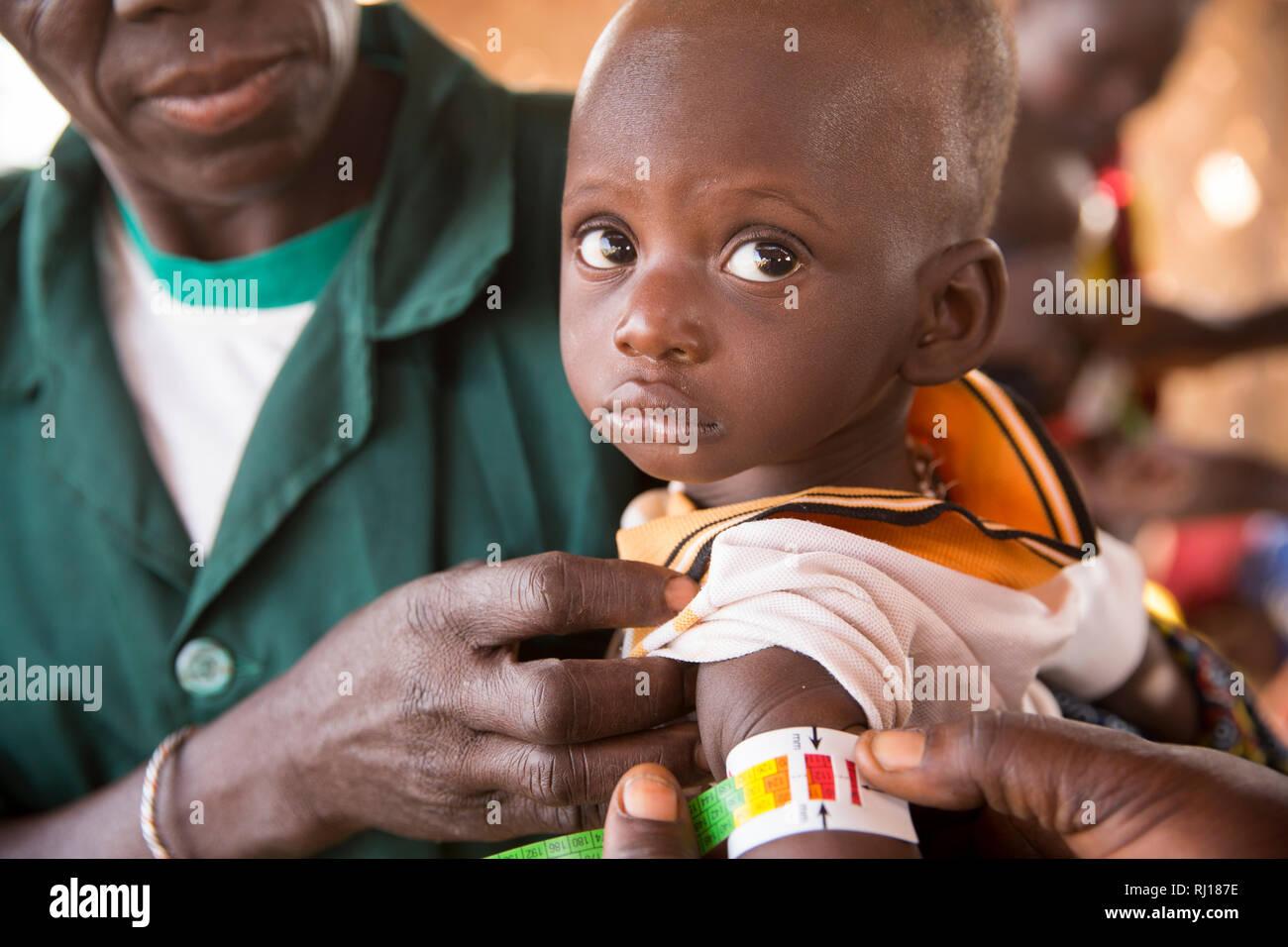 Samba village, Yako Province, Burkina Faso. CVN nutition team check children for signs on malnutition. Stock Photo