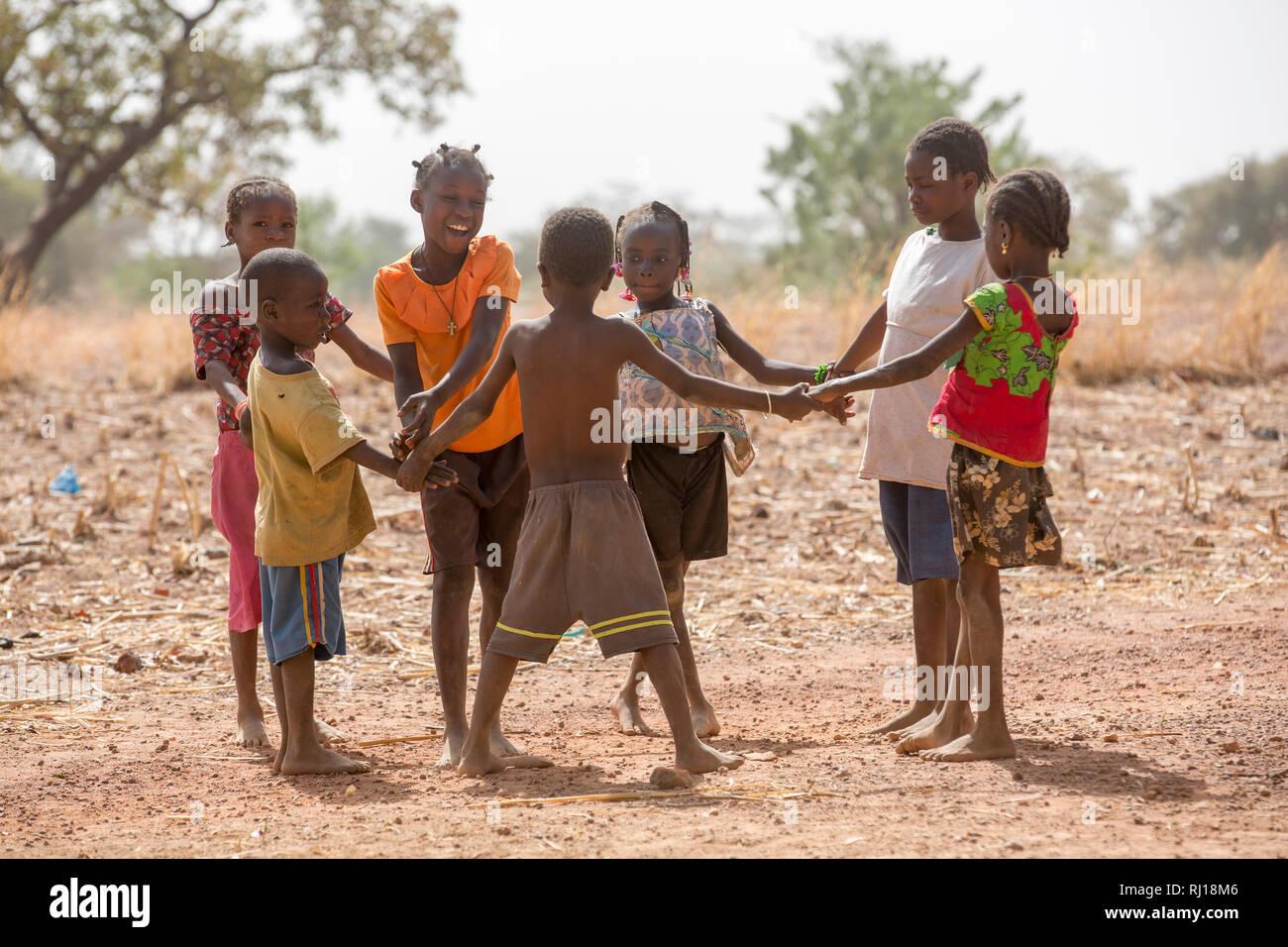 Samba village, Yako Province, Burkina Faso; children playing together. Stock Photo