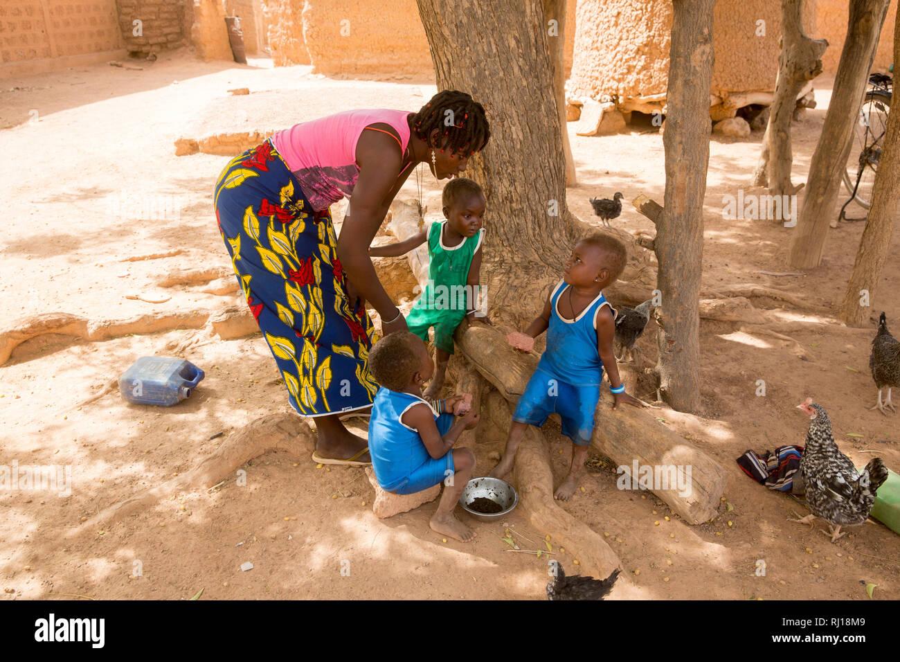 Samba village, Yako Province, Burkina Faso; Salamata Zoundi, 27, with her tiplets Christelle,  Christine and Christophe, aged 2. Stock Photo