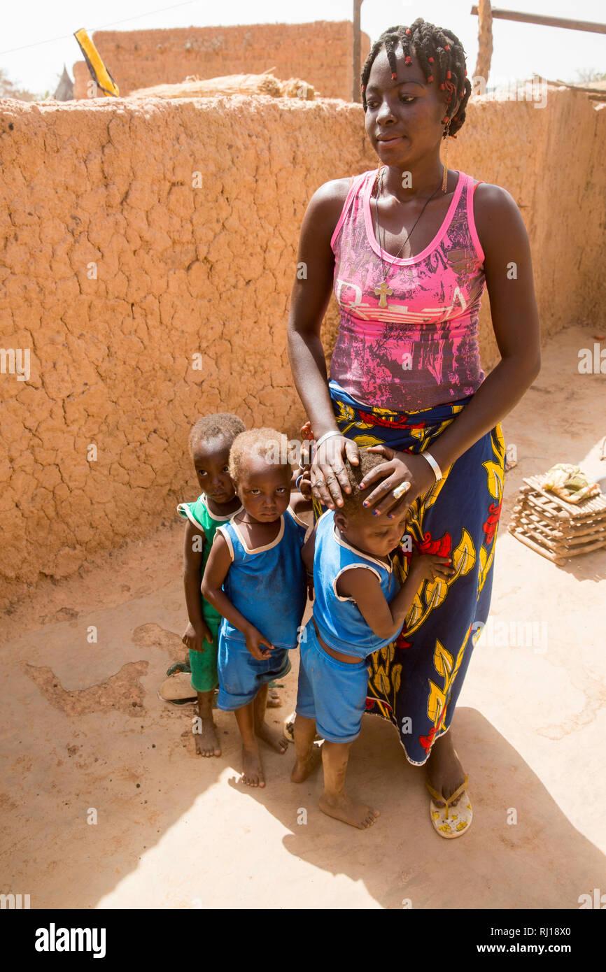 Samba village, Yako Province, Burkina Faso; Salamata Zoundi, 27, with her tiplets Christelle,  Christine and Christophe, aged 2. - Stock Image