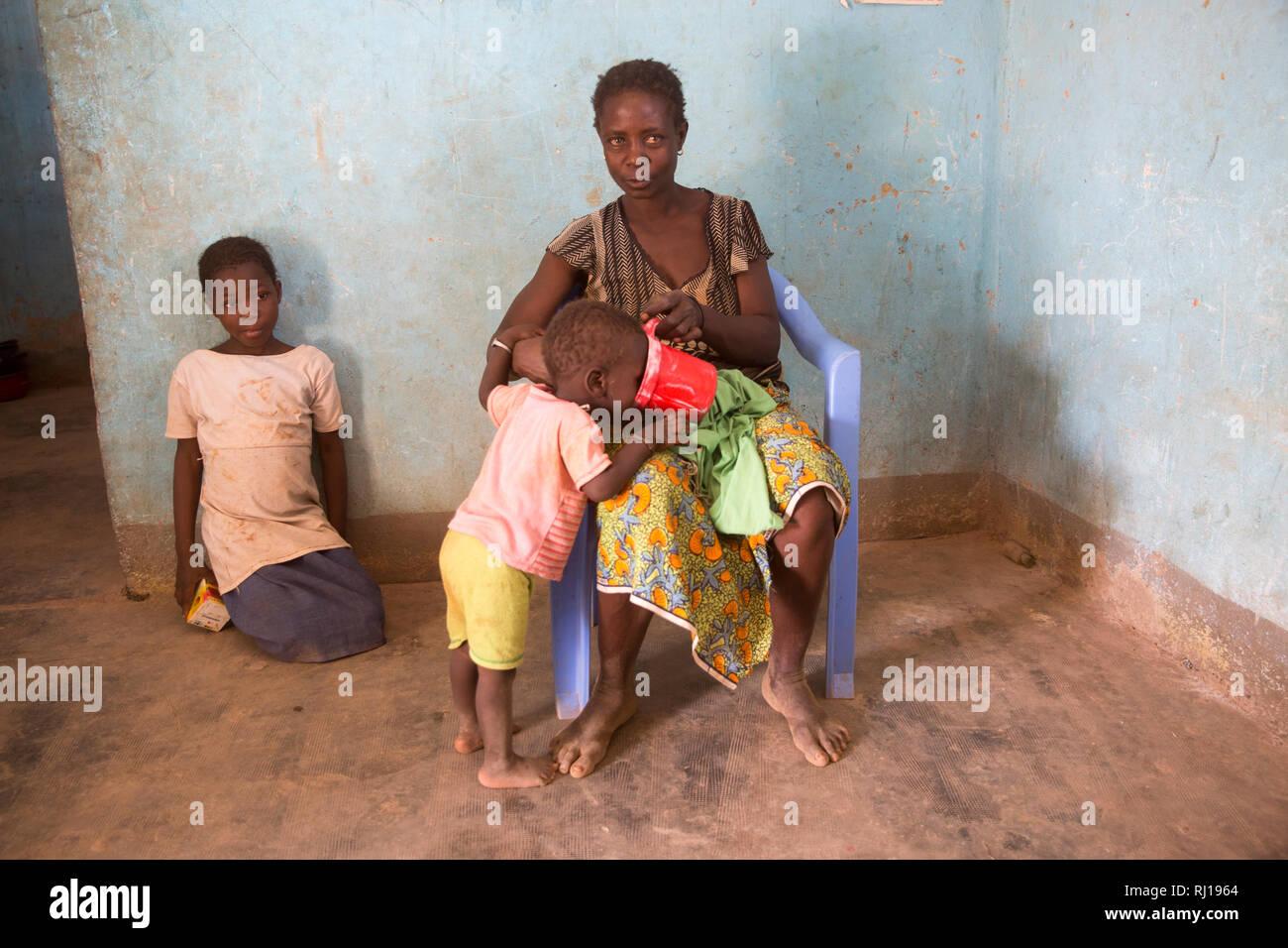 Samba village, Yako Province, Burkina Faso; Sally Zoundi, 35, with her baby Salomon Zoundi, 15 months, and her daughter Zalissa Zoundi, 10. Stock Photo