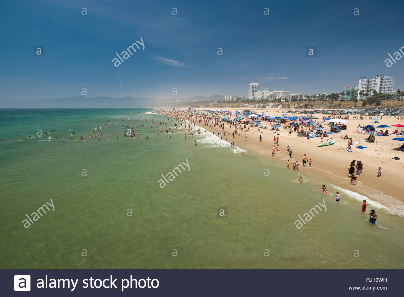 Crowds of people in the Pacific Ocean at the Santa Monica State Beach, Santa Monica, Los Angeles County, California, USA - Stock Image