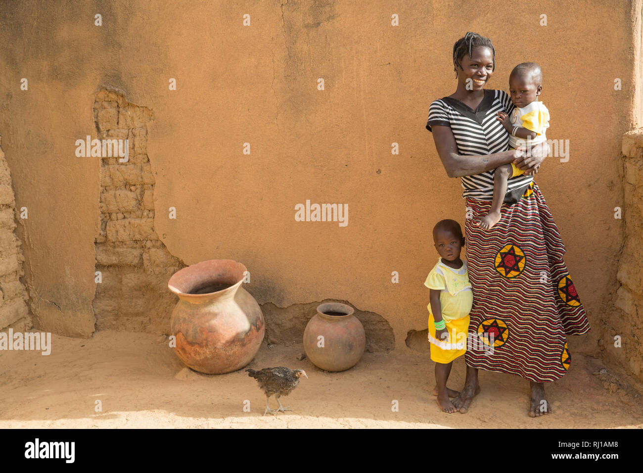 Samba village, Yako Province, Burkina Faso : Mamounata Kologo, 28, with her twins Abdmounourou  and Samiratou Zoundi, 20 month old. Stock Photo