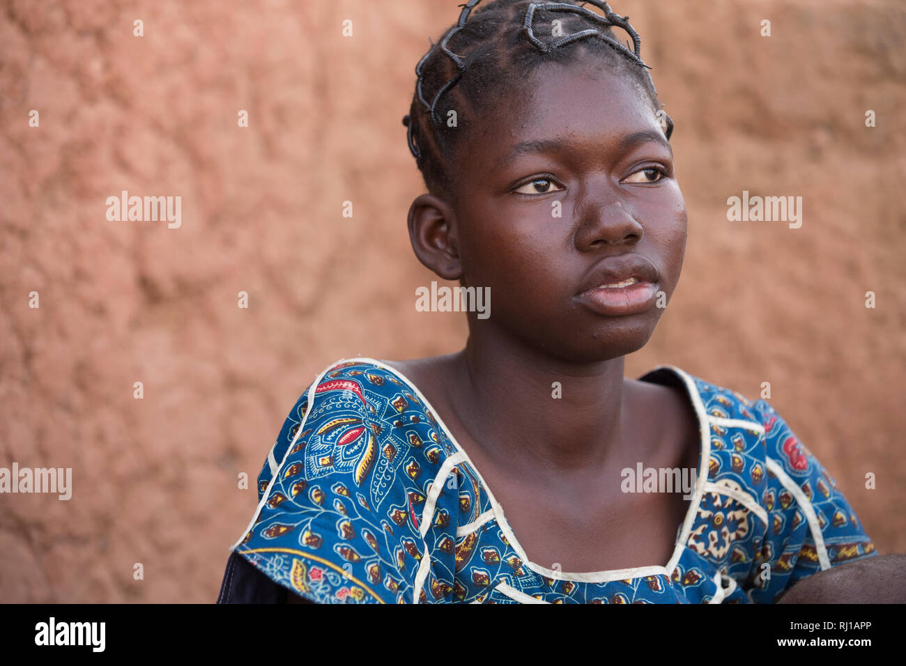 Samba village, Yako Province, Burkina Faso: Abzetta Sondo, 19,. Her child is suffering from acute malnutrition. Stock Photo
