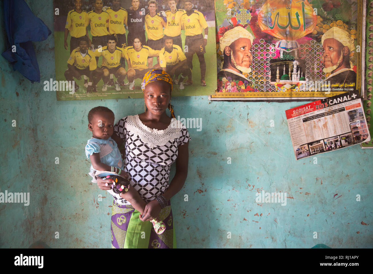 Baribsi village, Yako province, Burkina Faso; A teenage mothger with her young child at her parents house. Stock Photo