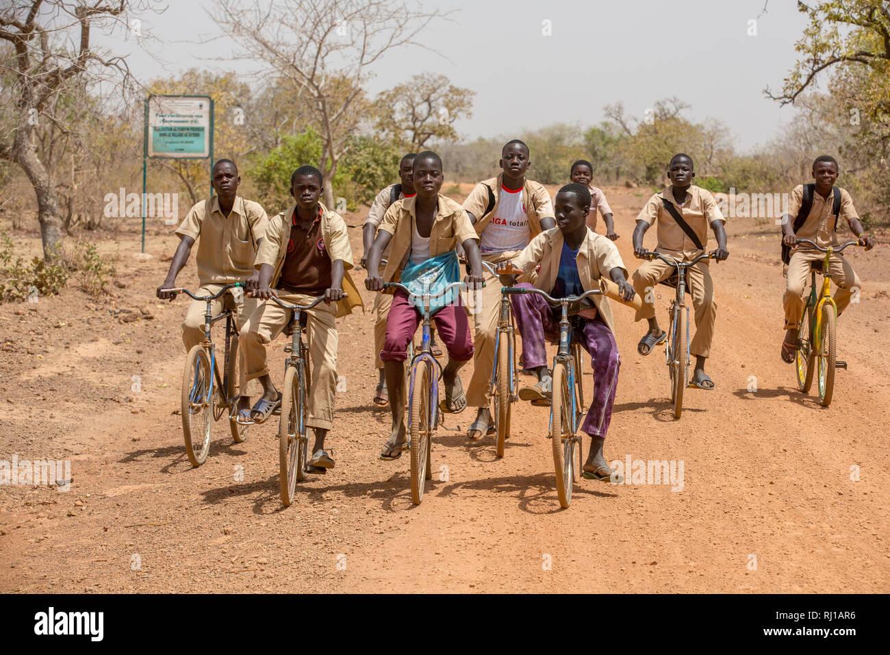 Yako Province, Burkina Faso; Boys return from school near Samba. Stock Photo