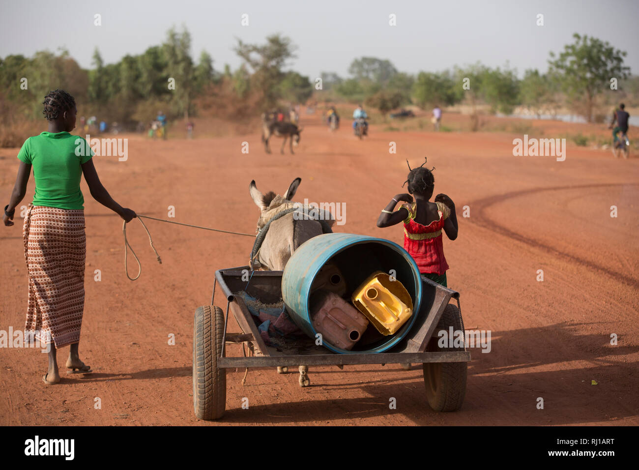 Samba village, Yako Province, Burkina Faso: Abzetta Sondo, 19, fetches water for her household. - Stock Image