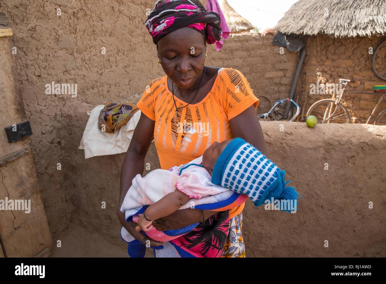 Kourono village, Yako province, Burkina Faso; Elizabeth Toro, 36, with her grand-daughter. Stock Photo
