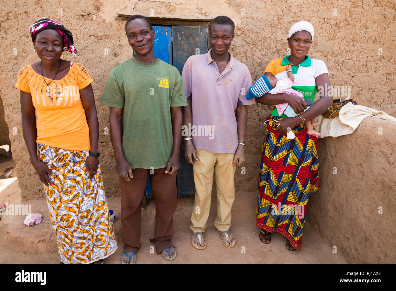 Kourono village, Yako province, Burkina Faso; Moussa Mande, 54,    with his wife Elizabeth Toro, 36, their son, daught-in-law and grand-daughter. Stock Photo