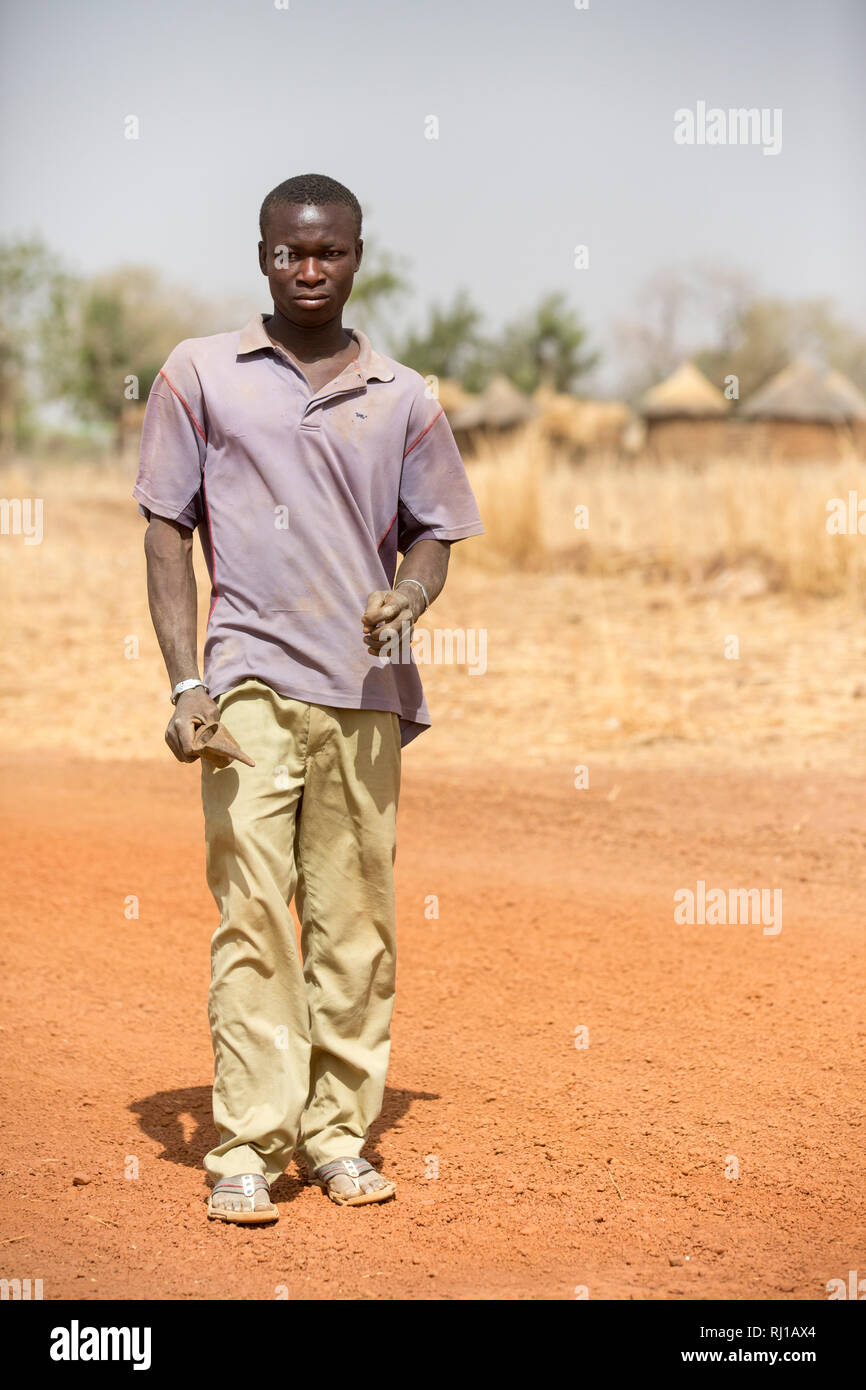 Kourono village, Yako province, Burkina Faso; Moussa Mande's eldest son on the way to the gold mines. He has no education, unlike his younger brothers and sisters. Stock Photo