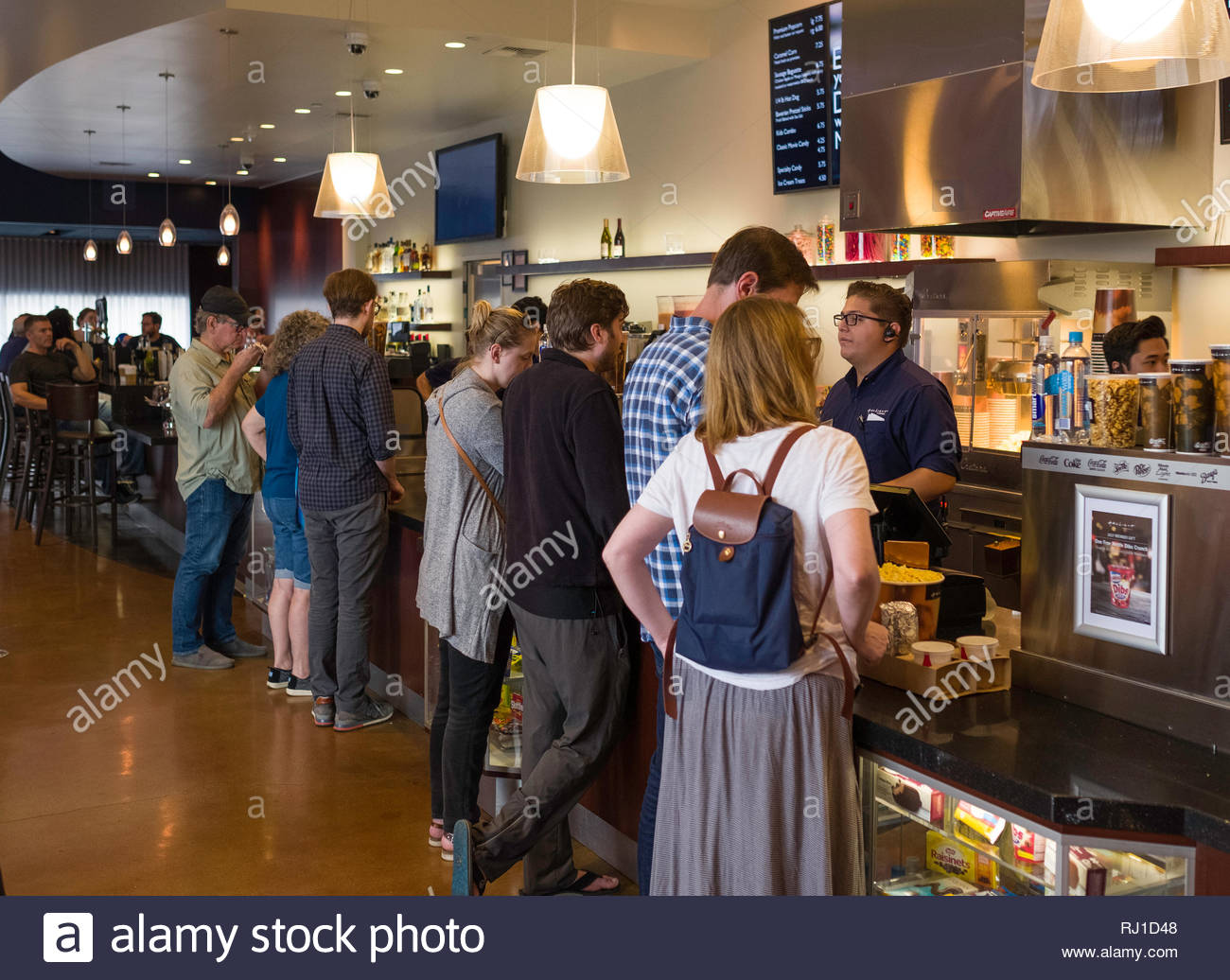 Customers standing at concession counter inside Arclight Cinemas buying food and drink before the start of their movie, Santa Monica Place, Santa Moni - Stock Image