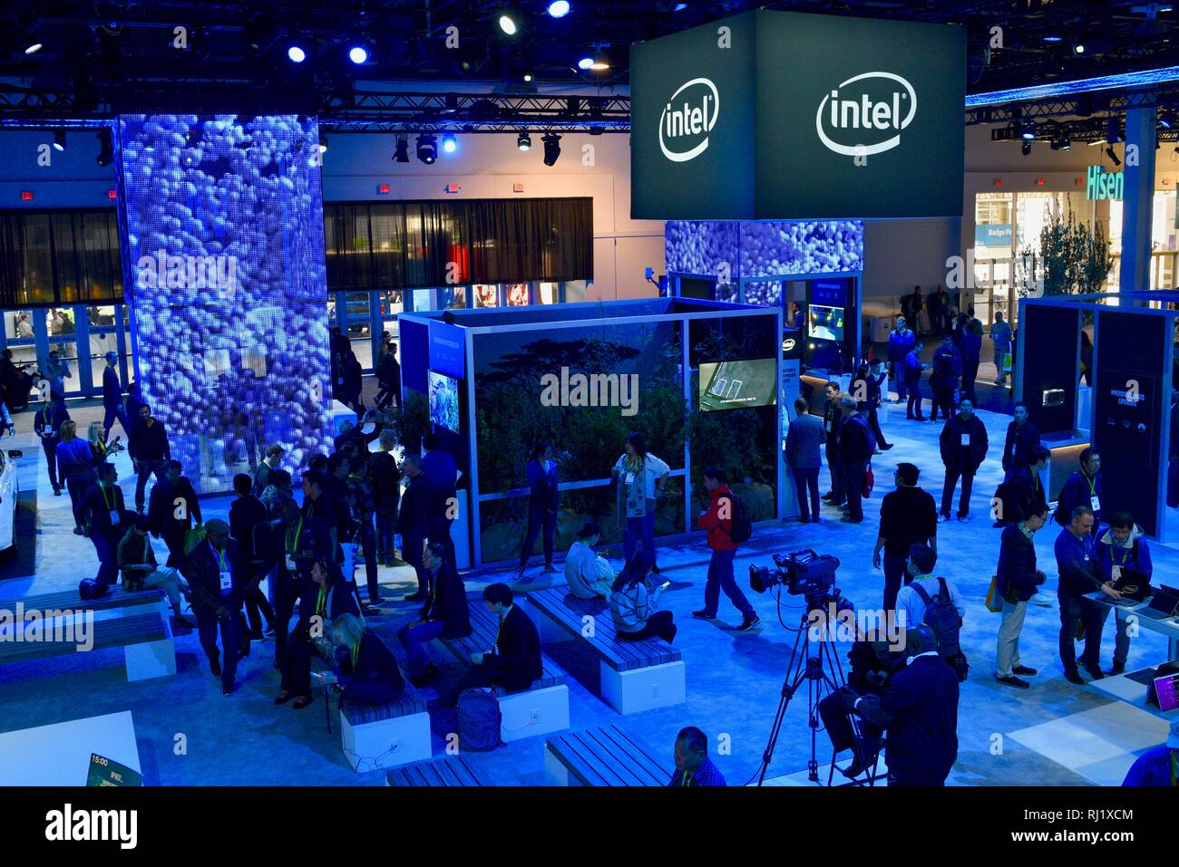 Attendees trying out demos of computers, augmented reality experience with Magic Leap One, video games, 5G at Intel booth at CES, Las Vegas, USA. Stock Photo