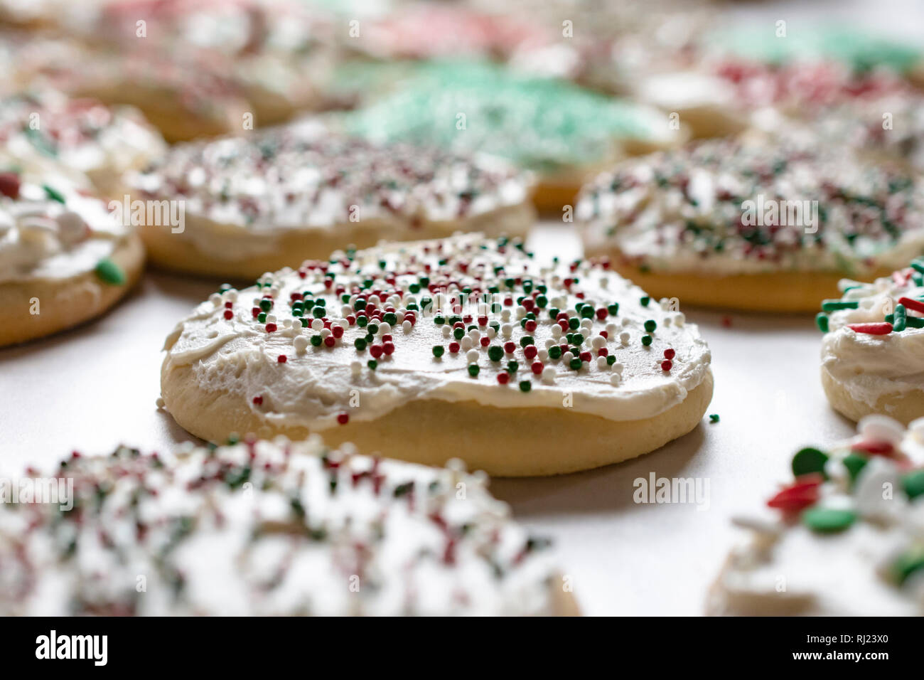Christmas Sugar Cookies Frosted With Sprinkles Close Up View Stock