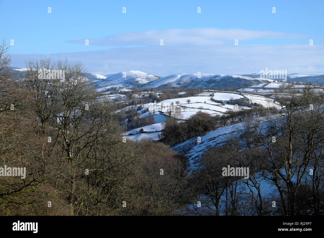 Snow on hills in sunny winter weather view north from Porth y Rhyd Llanwrda near Llandovery in Carmarthenshire Wales UK in February 2019  KATHY DEWITT - Stock Image