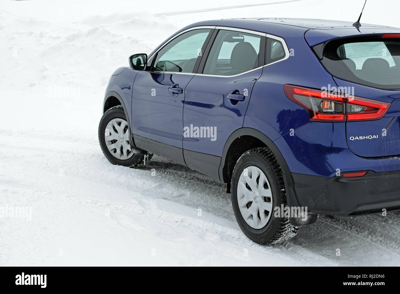 Aura, Finland - February 2, 2019: New Nissan Qashqai 2019 model (color ink blue) on snow. - Stock Image