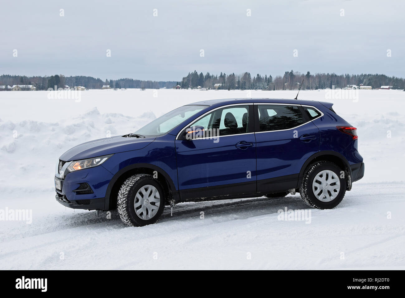 Aura, Finland - February 2, 2019: New Nissan Qashqai 2019 model (color ink blue) in snowy winter landscape. - Stock Image