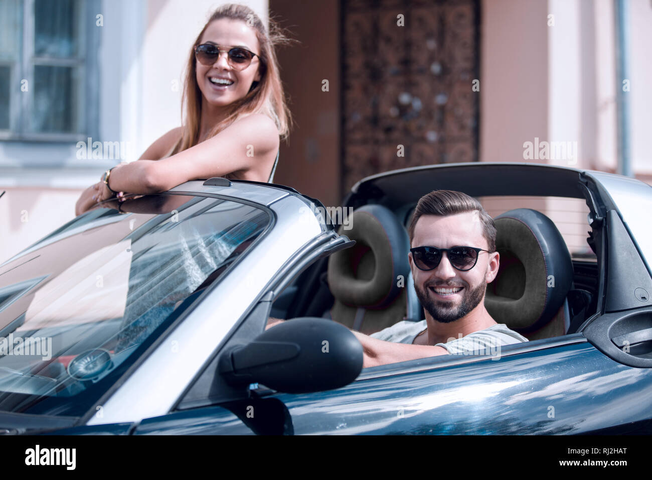 young couple in convertible car. - Stock Image