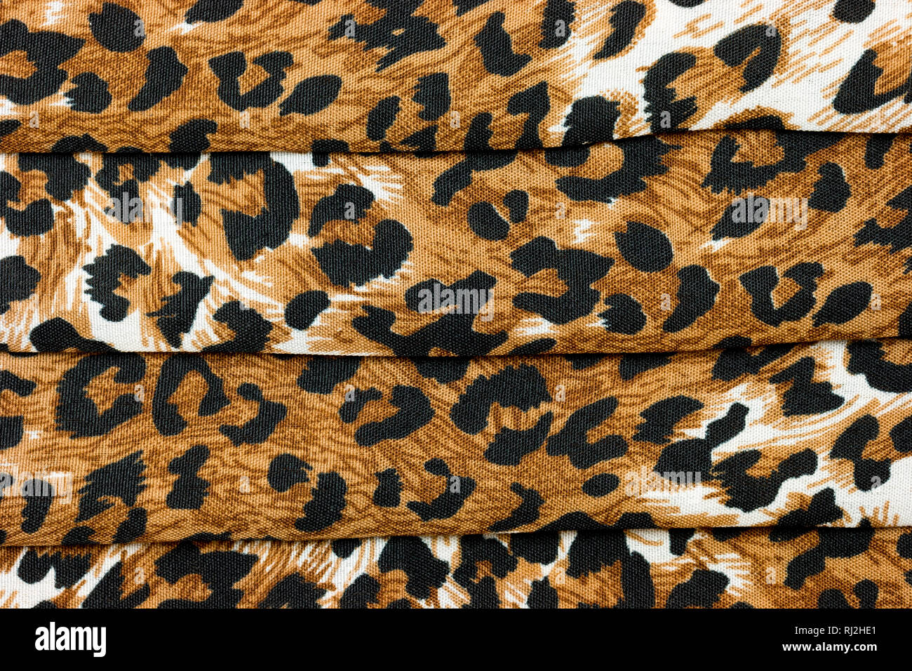 a63a5f0241 An abstract background of close up folded leopard animal print fabric