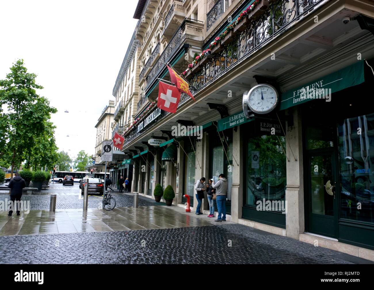 Hotel Longemalle and F.P. Journe Invenit et Fecit high-end Swiss watchmaker in Old Town Geneva Switzerland on rainy day - Stock Image