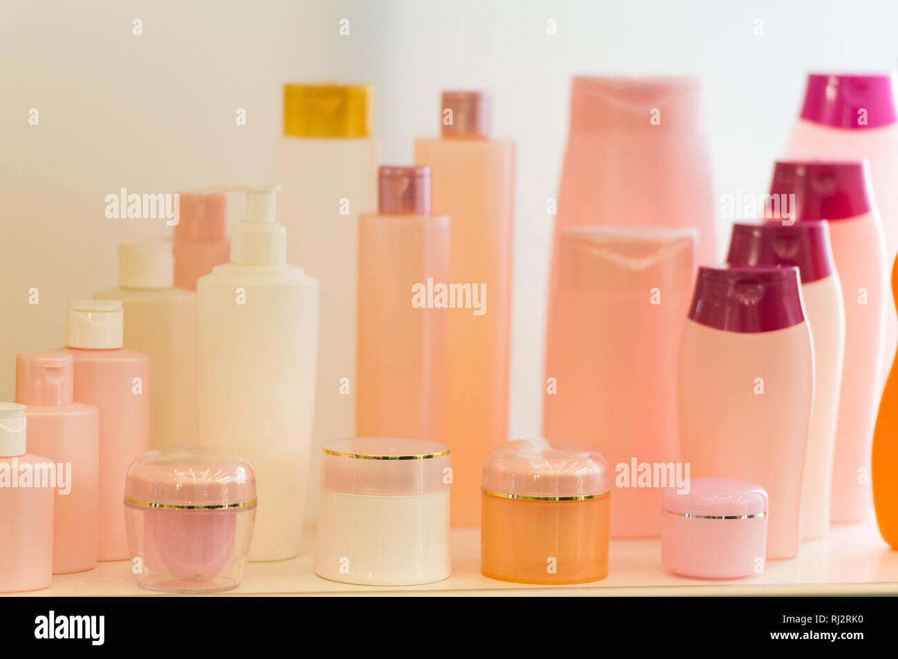 Composition with containers of body care and beauty products. Eco cosmetics. pink colors Stock Photo