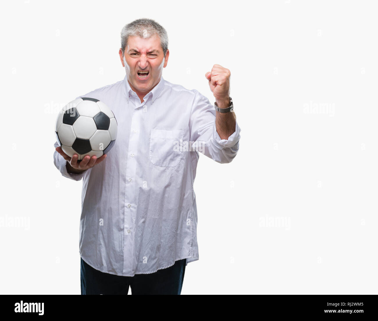 69525aa68 Handsome senior man holding soccer football ball over isolated background  annoyed and frustrated shouting with anger