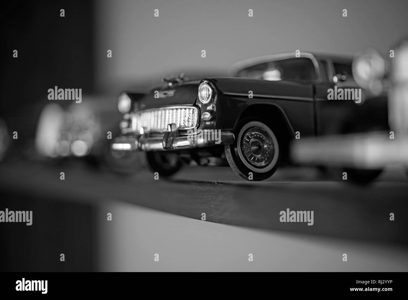 A close attention to the details. Retro styled cars. Toy cars with retro design. Retro car models on shelf. Classic model vehicles or toy vehicles - Stock Image