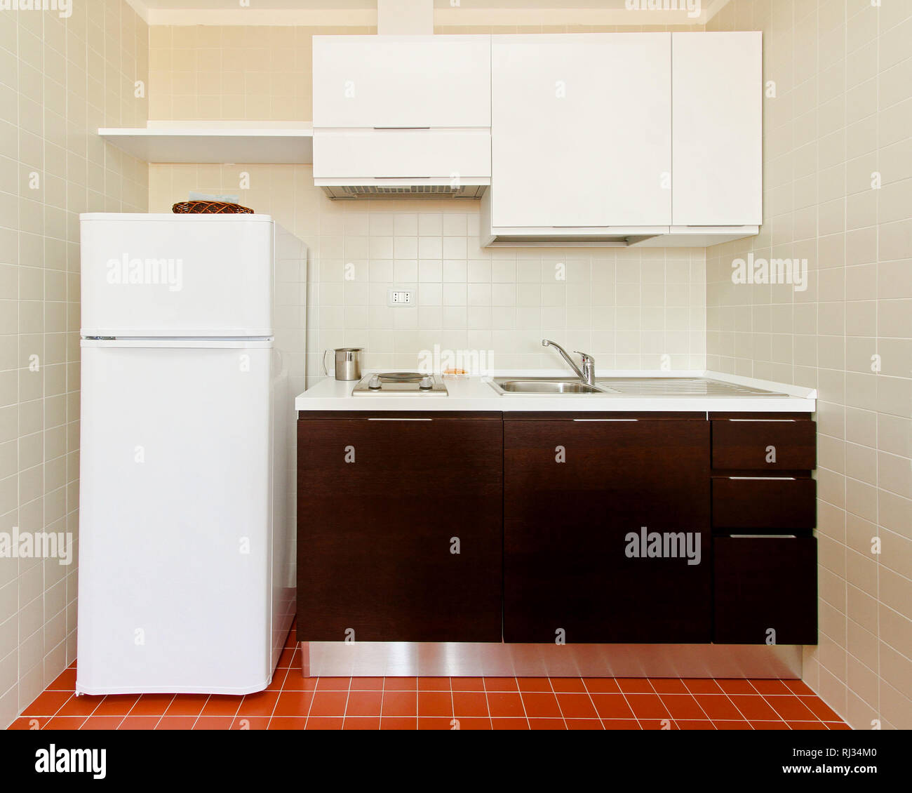 Kitchenette with all appliances in small apartment Stock ...