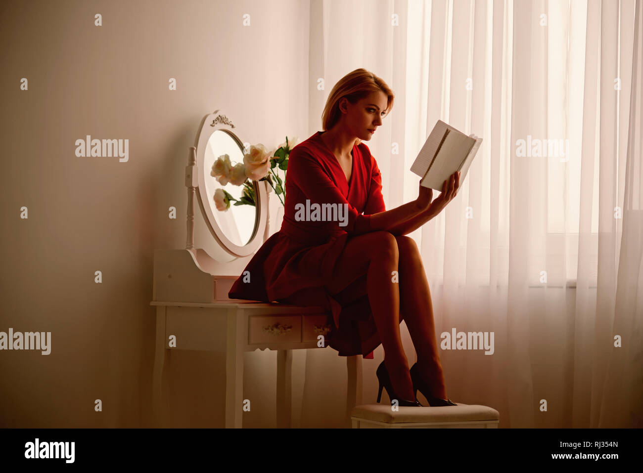 story reading. woman reading story in bedroom. story reading after working day. woman reading book. great story - Stock Image