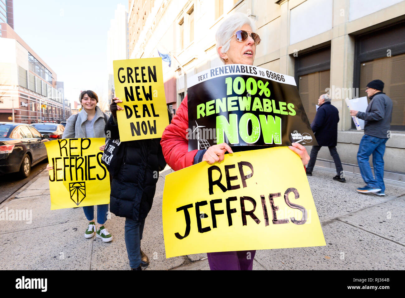 Demonstrators seen holding placards during the protest. 350.org, Food & Water Watch and other groups organized a protest to encourage U.S. Representative Hakeem Jeffries (D-NY) to support the Green New Deal. Protest was held in front of the Hanson Place office building in Brooklyn, NY. Stock Photo