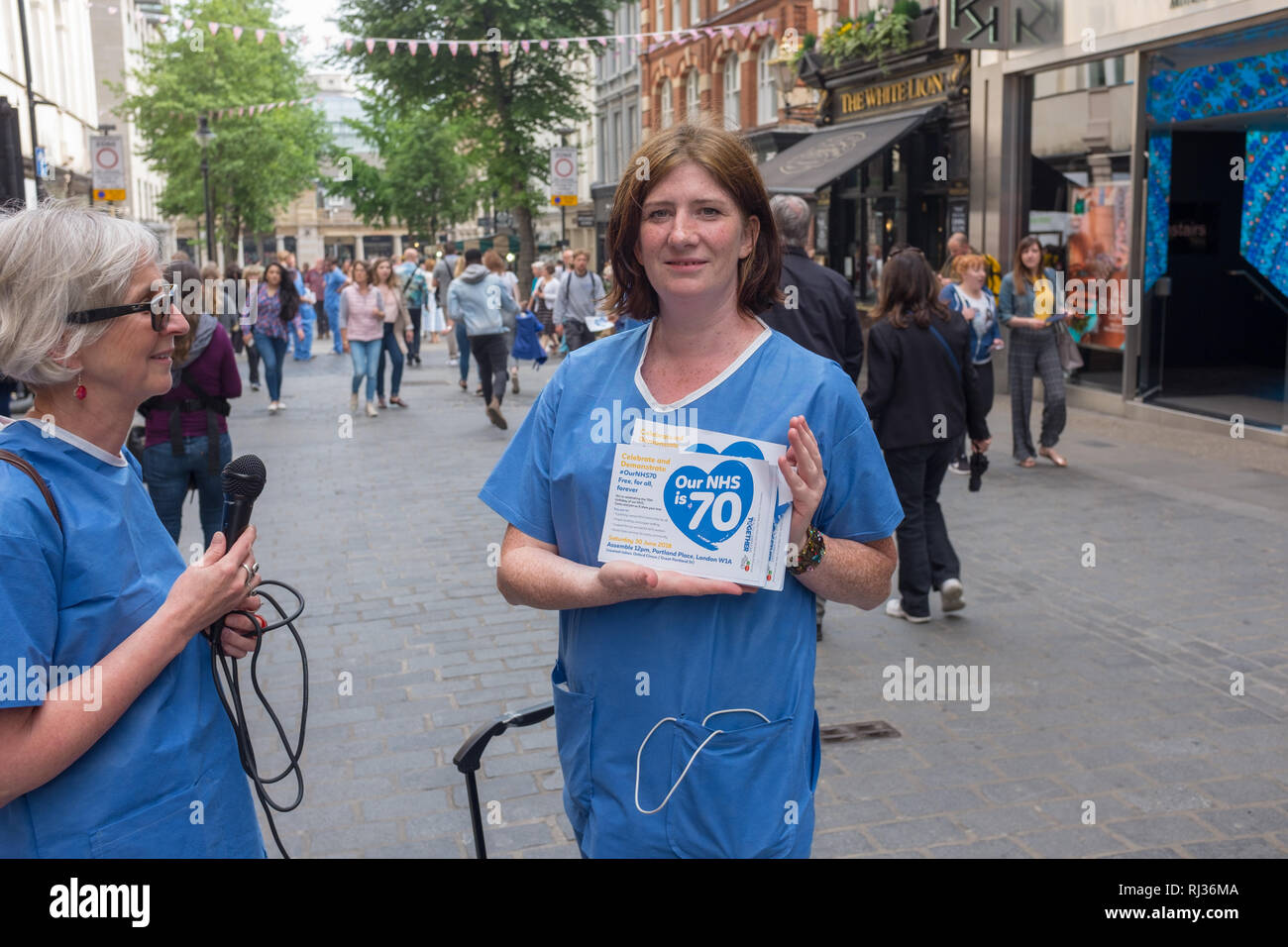 Doctors from the National Health Service (NHS) protest) against plans to privatize services Stock Photo