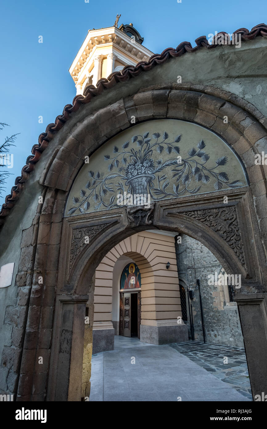 Looking through decorative archway to Plovdiv's Assumption of the Holy Virgin Church, Plovdiv Old Town, Bulgaria - Stock Image