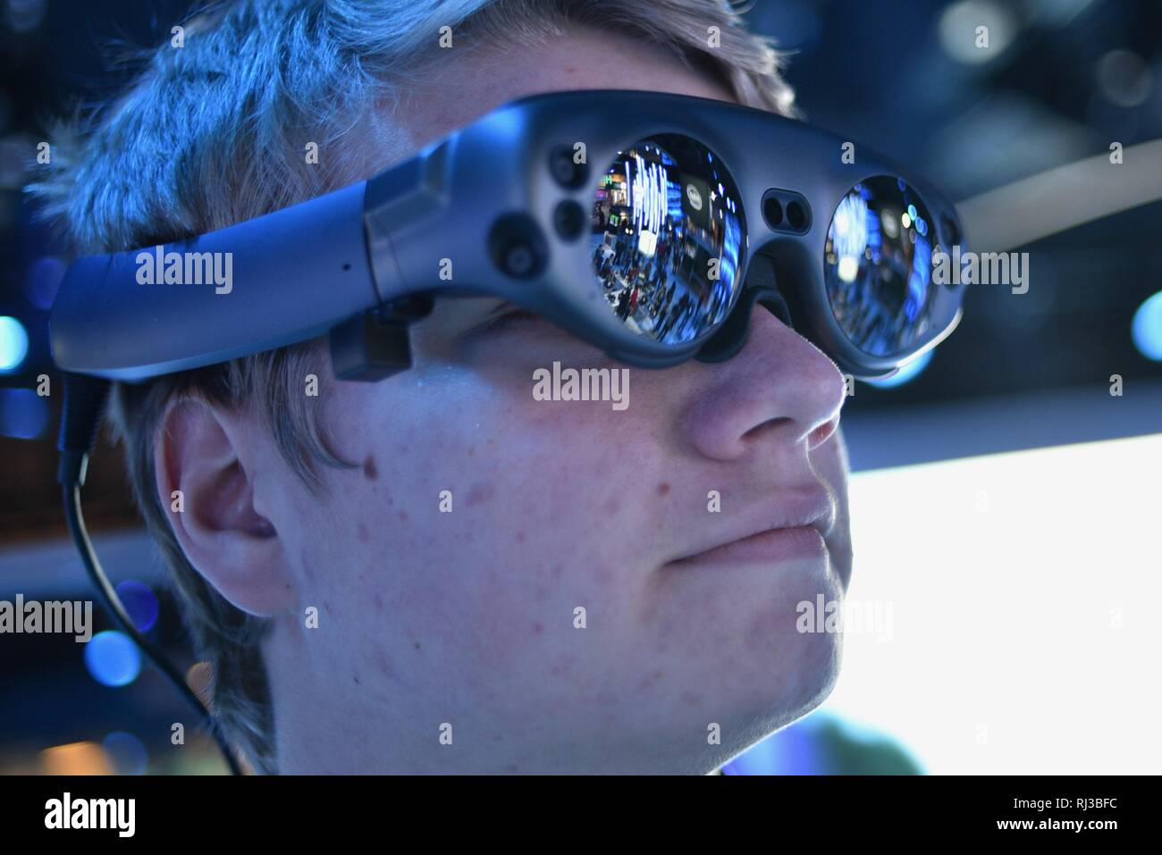 Using Magic Leap One mixed reality goggle for Mimesys debut of holographic collaboration as 2 people build drone at Intel booth at CES, Las Vegas, USA Stock Photo