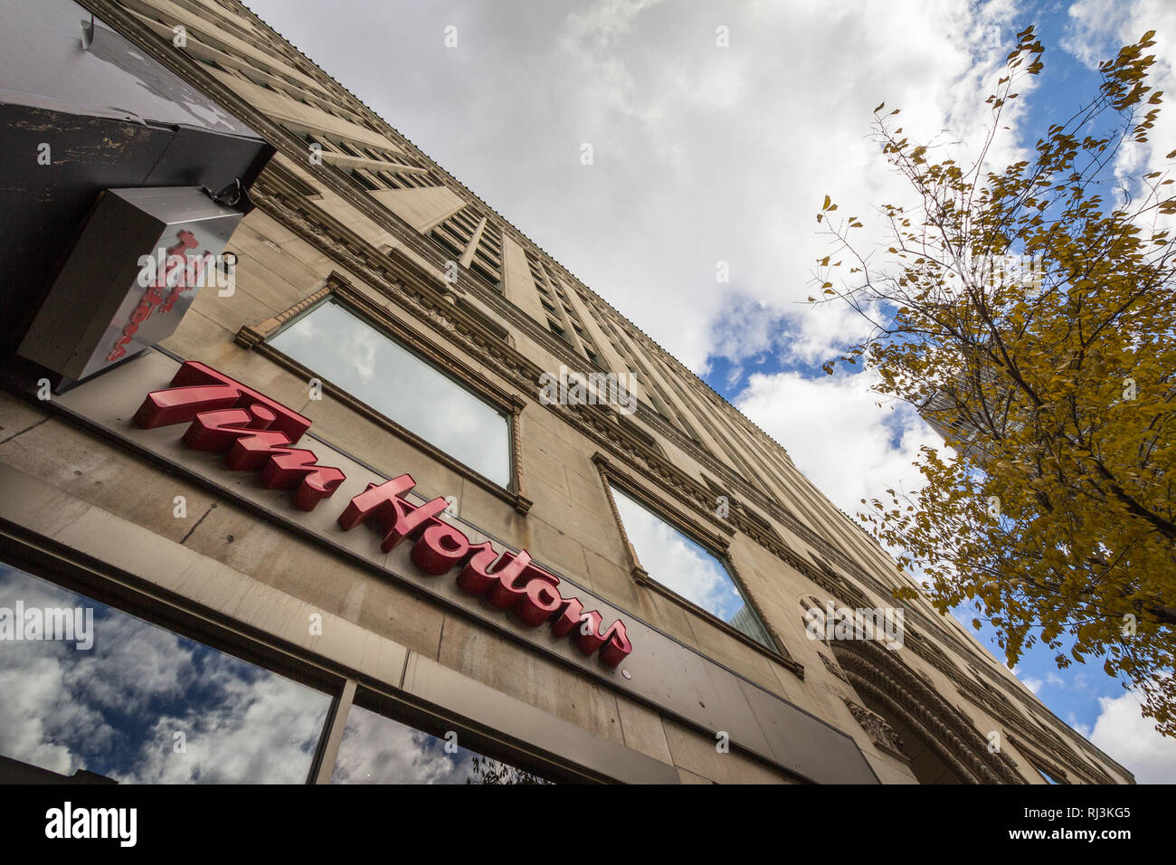 MONTREAL, CANADA - NOVEMBER 7, 2018: Tim Hortons logo in front of one of their restaurants in Montreal, Quebec. Tim Hortons is a cafe and fastfood can - Stock Image