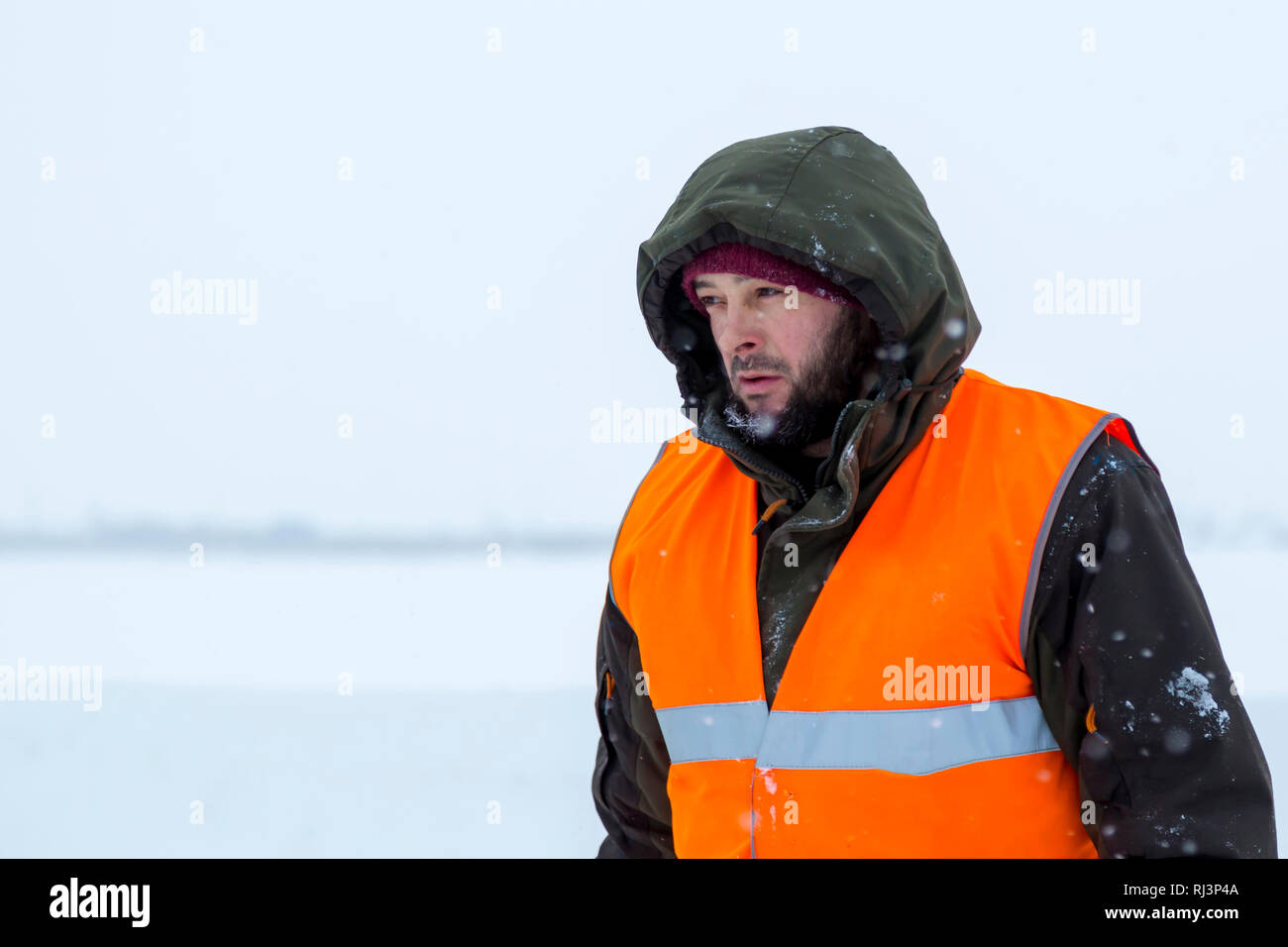 Portrait of installer in orange reflective vest - Stock Image